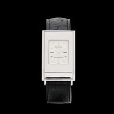 Tiffany & Co. Schlumberger ladies wrist watch features a solid 18k white gold 33.5mm by 23mm rectangular case with high polish on a Tiffany & Co. black ostrich leather bracelet. This analog watch has a Swiss made quartz movement for accurate time keeping. The watch is adjustable to many wrist sizes from approximately 5 3/4 inches to 7 1/2 inches. The original Tiffany & Co. packaging accompanies this sleek and sophisticated piece. CLICK PLAY ICON TO WATCH VIDEO