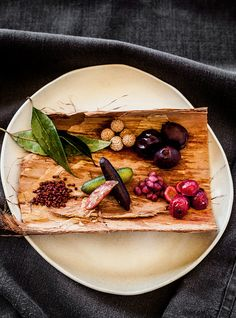 Native Plate with Davidson Plums, Lemon Myrtle Leaves, Quandongs, Reberries, Quandong Seeds and Finger Limes, on a bed of Paperbark at Longitude 131 - The Northern Territory - Australia - Photography by Kara Rosenlund