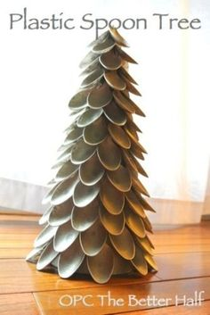 Christmas tree made from Plastic Spoons. Cost under five dollars to make! Great tutorial. #holiday #crafts #decor #TheBetterHalf by sammsfam...
