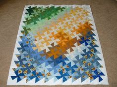 Using the twister cutter this beautiful design appears.  Look to see the before.  This is the after view.  The Quiltbeagle: Square Dance Quilt Top