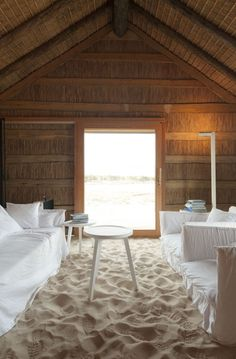 I would never do this in my house.....but how cool to have an outdoor space/structure with sand floors?