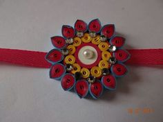 By Shweta Paper Quilling Earrings, Quilling Craft, Quilling Designs, Quilling Rakhi, Handmade Rakhi Designs, Rakhi Making, Paper Jewelry, Paper Plates, Origami