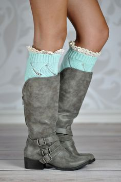 TURQUOISE GEOMETRIC BOOT CUFFS Boot cuffs make your boots stand out every time! These lovely aqua knitted boot cuffs are the perfect accessory to your favorite boots adding a nice touch with the scalloped white lace around its top rim. The geometric knitting pattern adds a unique look to these hand crafted soft cuffs.