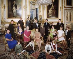 1971 - The royals take great candids, too, like this photo taken the day after Christmas in 1971 at Windsor Castle.  Back row, left to right: the Earl of Snowdon, the Duchess of Kent and Lord Nicholas Windsor, the Duke of Kent, Prince Michael of Kent, Prince Philip, Prince Charles, Prince Andrew and Angus Ogilvy.  Middle row, left to right: Princess Margaret, The Queen, the Earl of St. Andrews, Princess Anne, Marina Ogilvy, Princess Alexandra and James Ogilvy.  Front row (left to right) Lady…