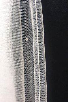 Stunning Veiling quality used, this shows thread edge finish with detail of a Swarovski crystal. This is optional. Available in White, Ivory and  Winter White.  Different lengths available.