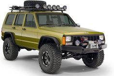 Jeep Cherokee - Ideal image, tow bumper, roof rack, KC lights, even the color. Just mount the spare on the rear and I'll take her