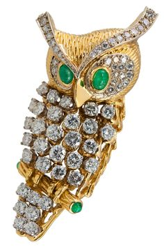 CARTIER OWL CHOUETTE BROOCH ~ 18k gold set with diamonds and emeralds.