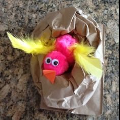 Not sure theres a lot of educational value to this craft, but my daughter brought it home from preschool today, and its adorable!  A brown paper sack rolled down with pompoms, feathers and eyes-- construction paper beak!  Perfect nest! librarysusieq