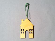Festive Ornament House, Yellow with Green String. Featured in 2014's November issue of HGTV™ magazine.