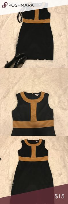 New York & Company Sleeveless Dress Black and gold sleeveless sheath dress with zipper back. Like new condition. Comfortable cool dress. This dress has a 35.5 Length. New York & Company Dresses