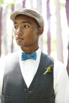 Try wearing a vintage hat with a vest and accented bow tie.