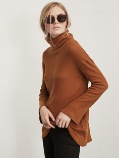 Like you never got out of bed. The Gladstone Sweater is just something to keep you cozy. This is a super soft, brushed medium weight ribbed jersey sweater with a slouchy oversized turtleneck and long flare sleeves. The fit is loose and comfy and the fabric feels like your pillow, except better. Made from 95% tencel, 5% spandex.