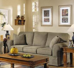 Features This sofa has quality,value and style. It features a dressmaker skirt, coordinating arm pillows and traditional rolled arms. 2 toss pillows are includ
