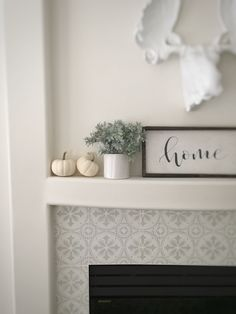 In this Stenciled Tile DIY Fireplace Makeover, I share how I updated my fireplace by painting the brass and painting and stenciling over the existing tile Paint Fireplace Tile, Brick Fireplace Makeover, Home Fireplace, Fireplace Remodel, Fireplace Ideas, Cost Of Laminate Flooring, Vinyl Plank Flooring, Wood Laminate, Man Cave Flooring Ideas