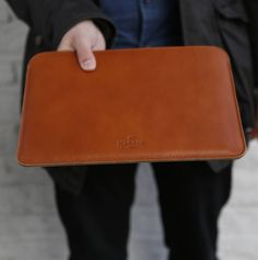 A minimal slim leather MacBook sleeve case with 100% wool felt lining for extra cushioning. The perfect gift for him! Our Slim Leather MacBook Sleeve has been designed with only one purpose. To protect your laptop in style. A classic leather sleeve that never goes out of fashion. Perfect to carry around or to put it inside your bag without worrying that your gadgets will be scratched. The minimalist design has an old school craft and it has been hadmade with traditional craftsmanship and…