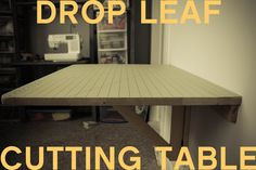 DIY Drop Down Cutting Table tutorial by Grosgrain Fabulous.  I think this table would be equally useful as a workshop table or arts & crafts station.  :)