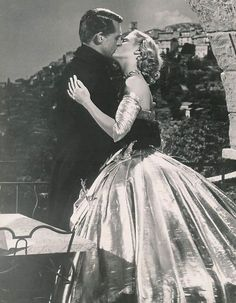 British born actor Cary Grant and American actor Grace Kelly kiss under an archway in a still from director Alfred Hitchcock's film, 'To Catch a Thief,' Kelly wears a strapless ball gown. Get premium, high resolution news photos at Getty Images Grace Kelly, Patricia Kelly, Old Hollywood Glamour, Golden Age Of Hollywood, Vintage Hollywood, Hollywood Stars, Vintage Vogue, Cary Grant, Hitchcock Film