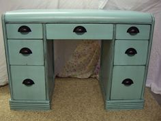 Refinished waterfall desk. I'm not crazy about the color, but I love the hardware.