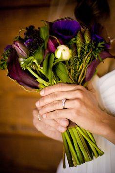 Bouquet made of purple anenomes, purple tulips, dark purple lilac, white ranunculus, dark purple callas, leucadendron and curly willow.