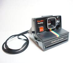 Rainbow One-Step Polaroid - I totally want to buy one of these!