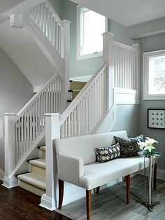 I want to REDESIGN a the basement steps to have more of a feel like this. I adore this staircase. Casual. Crisp. Clean. Dark engineered wood, Lightly Shaded walls, white trim, and for zest, metalic tiles or wood tiles on the ceiling.