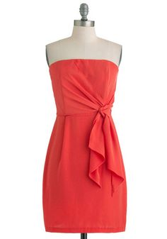Classy strapless coral dress.    The tie on the side would probably be very flattering. Could be a great bridesmaid dress.    It's a Tie Dress