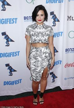 Beach babe: Demi Lovato, 22, rocked an island-themed skirt and top that exposed her midrif...