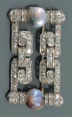 An Art Deco whilte gold, diamond and grey pearl brooch. #ArtDeco #brooch