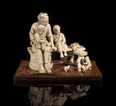 A large Tokyo school ivory okimono of an old man with two children By Hokei, Meiji period (late 19th century)