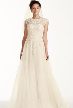 Cap Sleeve Tulle Sheath with Lace Applique WG3769   David s Bridal     Brides  Oleg Cassini at David s Bridal   See more Oleg Cassini Gowns from  David s Bridal Tulle ball gown with illusion neckline  cap sleeves and  beaded