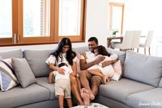 Family cuddling on the couch in these Lifestyle Photos at Home