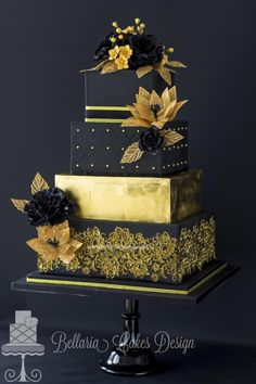 A stunning stylish & chic black & gold #wedding cake with the second tier of 24 carat of gold leaves x