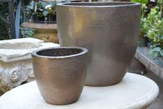 Bronze Egg Planters from Detroit Garden Works, Gardenista Large Outdoor Planters, Garden Planters, Planter Pots, Garden Works, Garden Art, Garden Ideas, Warm Colors, Neutral Colors, Landscaping Near Me