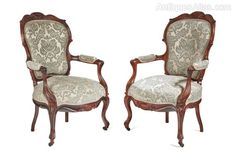 A pair of french rosewood open arm chairs,a very rare opportunity to own a matching pair of armchairs of this quality and condition, lovely shaped back and arms, carvings to the chair frames,standing on nice cabriole legs to the front outswept back legs, newly recovered in a fantastic fabric,