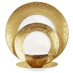 BIG BANG GOLD DINNERWARE -- Jaune de Chrome Big Bang Gold is white Limoges porcelain decorated with a wide band of rich gold. The pattern has been given a textured dappled effect with a mix of brilliant and matte gold.  Gearys Beverly Hills -- gearys.com