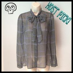 💞HP💞 MICHAEL KORS Sheer Button Up Blouse Top In good used condition. MICHAEL KORS Sheer Button Up Long Sleeve Blouse Top. Size Small. Shirt has a fun pattern with black, white & blue. Cute tie that can be tied/worn in different ways (some pictures in #2). 100% Polyester. This shirt is sheer so you may want to wear a cami underneath, unless you just want to be daring. 😉  💗Bundles 👍🏼Reasonable Offers 🚬 Free ☠NO TRADES☠ Michael Kors Tops Blouses