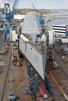 The DDG-1000's tumblehome hull is plainly visible in this sharp bow view.  The tumblehome hull is fuller and wider at the waterline and below than above. The ship's maximum beam is 80.7 feet on a length of 600 feet