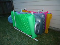 My hubby built this for our pool floats.  Easy, Cheap and efficient!  No more trying to store those floats during the summer when we use them daily!  Pvc pipe, glue, and bungie cords.