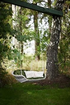 Wicker tree swing. A peaceful rest under the shade tree.