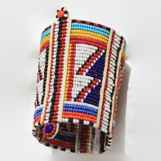 Beaded wristband made by Maasai family in Kenya. This is a traditional cuff bracelet worn by Masai men and women in Africa. The bracelet is about