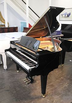 A 2004, Kawai GE20 baby grand piano for sale with a black case and square, tapered legs at Besbrode Pianos £6500