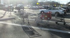 These carts were doing two things -- basking in the sunshine and also attempting to get the attention of a nearby Mustang convertible. if you can't run with the big boys, at least hang out with them.