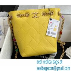 Chanel Resin Chain Lambskin Drawstring Bucket Bag AS2381 Yellow 2021