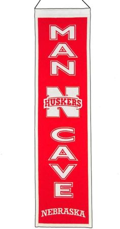 """$45 - NCAA Nebraska Cornhuskers Man Cave Banner - Every man cave needs this pride-packed Nebraska Cornhuskers banner. Official team graphics & colors Ready to hang 32""""H x 8""""W Wool Spot clean Imported Shop our full assortment of Nebraska Cornhuskers items here. When you're a fan, you're family! Size: One Size. Color: Multicolor. Gender: Male."""