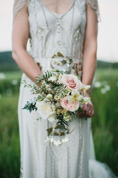 Blush pink & white rose bouquet with wild green foliage - Image by Peach & Jo Photography - Jenny Packham Eden Dress & Acacia Headpiece with mis-match vintage bridesmaid dresses for a gold botanical outdoor wedding in Shipley Gardens.