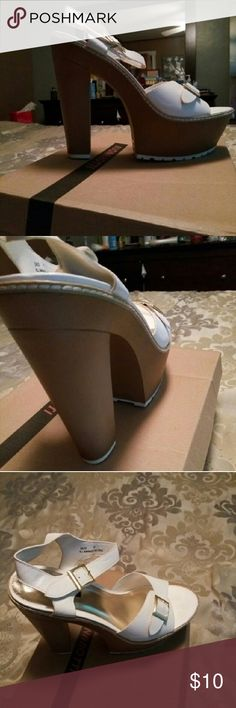 White platform sandals Never worn, fun ...goes great with a wide leg jean! Shoes Platforms