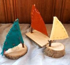 crafts boys these boats are so simple...  pieces of wood, fabric for the sails and a stick for the mast!  Y-Guides Craft