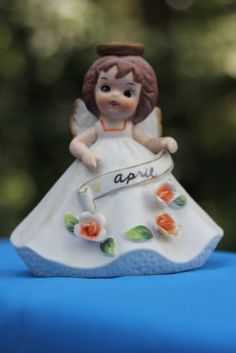 Vintage Josef Original April Birthday Angel Figurine with Halo. $20.00, via Etsy.
