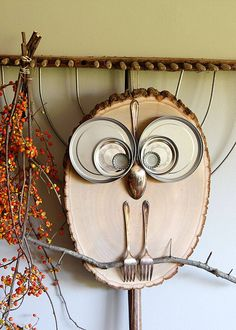 owl craft using slice of tree trunk, forks, spoon and metal lids
