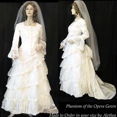Victorian Wedding Dress Costume. This fabulous gown was used in the theater version of Phantom of the Opera. The bodice is adorned with beaded appliques on the front, trimmed with ivory scroll trim and has full rows of embroidered lace at the 3/4 length sleeves.   See the site for more!